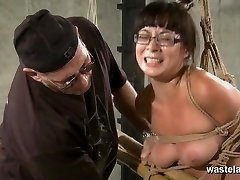Trussed and corded slave in glasses has orgasms