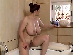 Well stacked brunette milf dildo fucks her cleavage in the bathtub room