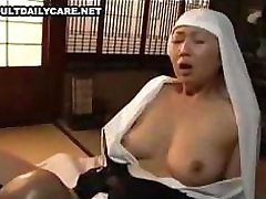 Asian babe sucks on his cock and then fucks it with headdress on