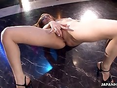Asian stripper getting wild on the pole as she drains