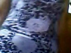 Elder Filipina showcase shaved pussy.