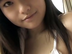Big-chested Japanese hottie demonstrates her charms in milky bikini