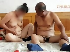 Asian grandpa giving it to grandmother from behind