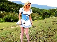 Blonde glamour teasing outdoor in forest