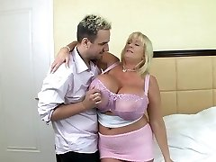 Blonde mature with huge silecone melons