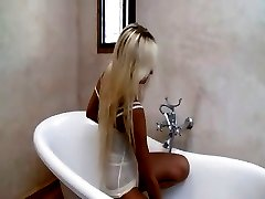 breasty blonde babe teasing with shower