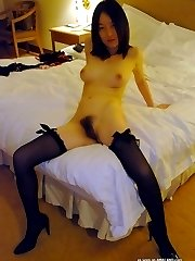 Chinese babe in stockings spreading her cunt