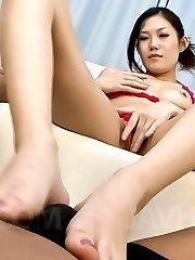 Yui Komine Asian with juicy boobies rubs boner with oiled feet