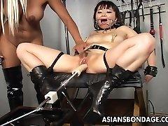 Beautiful blonde bitch dominates the slut with a fuck machin