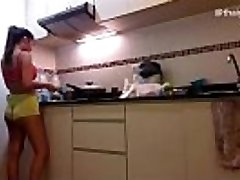 Amateur Asian Dame Strips naked while cooking in her kitchen