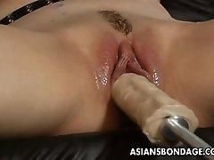 Wonderful blonde mega-bitch dominates the slut with a fuck machin