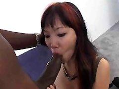 Little Asian taking big ebony cock