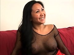Guy gets a sole job from a cute chinese in fishnets