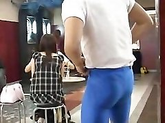 Beefy guy displays very cute busty Japanese chick in a bar