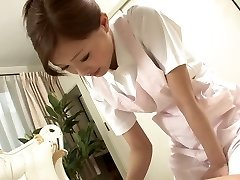 Sexy Nurse jerks her patient's spear as a therapy