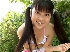Super-cute Korean college student poses in bathing suit in the garden