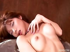 Insatiable Serina in candlelight toys her unshaved vulva over and over again