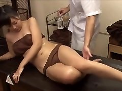 The young wife was tempted by the masseur's gigantic hard-on, fucked nearby husband