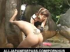 Tomoka Matsunami fucks fellow in hatch and ass with strap on outdoor
