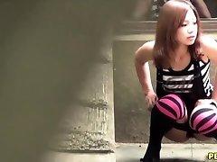 Asian slut pee squats