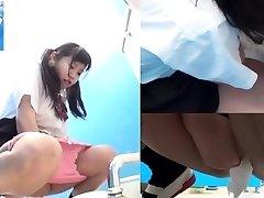 Asian teens pee in restroom