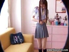 Asian schoolgirl gets hot for lucky hidden cam