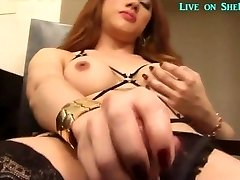 Hot Asian she-male jerks off