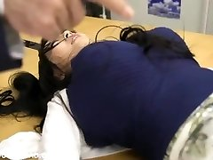 Giant huge-chested asian babe playing with dudes at the office