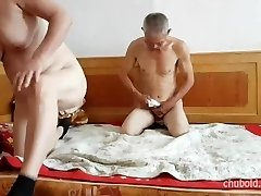 Handsome Chinese grandpa giving pounding