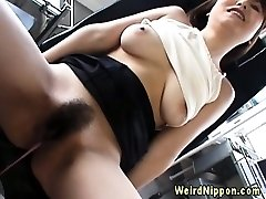 Japanese babe fucking a bottle up close