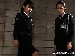 Bone starved asian police women giving handjob in jail