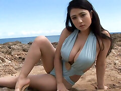 Sporty Japanese sweetheart Nonami Takizawa shows off her juicy udders on webcam outdoors