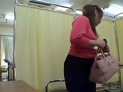 Bulky Asian pussy fingerblasted and toyed in medical fetish video
