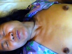 Ugly japanese cunt lies on bed