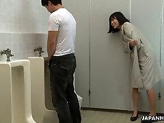Crazy Asian damsel Uta Kohaku pees on dick of one stranger dude in a public toilet