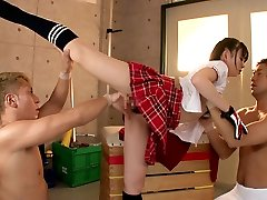 Flexible girl Drills Two Guys In The Gymnasium