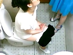 Two cute Chinese girls spotted on a restroom cam pissing