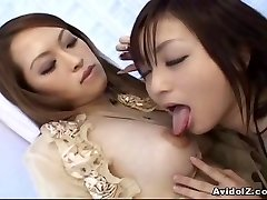 Asian lesbians playing with faux-cocks