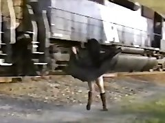Japanese girl in trench cover flashes train