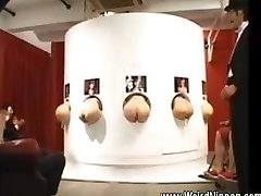 Chinese butts plunging out of gloryholes
