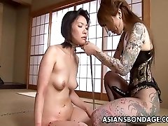 Tatted up Asian domina strap on fucking the slave