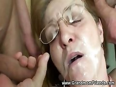 Horny grandmother gets facial from men