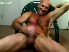 Muscledude Sittin Dicked and Beating Off Gigantic Cock