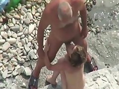 senior & youthful straight bottom nudist at the beach