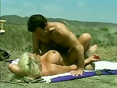 Classic Hugetitted Babe Poked on Beach