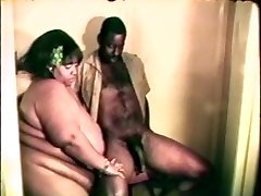 Big fat gigantic black bitch likes a stiff black cock between her lips and legs