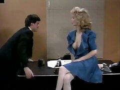 Busty cutie Christy Canyon gives hot blowjob to her co-worker