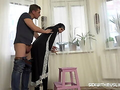 Super-steamy Muslim woman doing extra cleaning