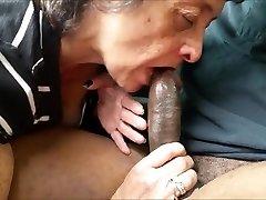 Hungry grandma tonguing a big black boner