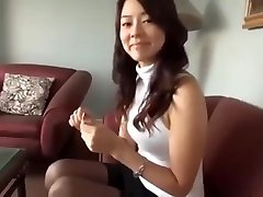 Attractive Japanese chick in hot black nylon pantyhose getting wild and horny on the couch